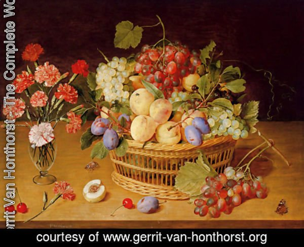 Gerrit Van Honthorst - A Still Life Of A Vase Of Carnations To The Left Of A Basket Of Fruit