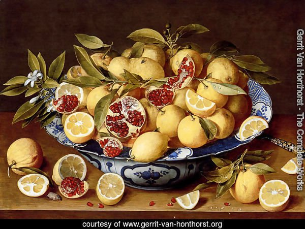 A Still Life Of A Wanli Kraak Porcelain Bowl Of Citrus Fruit And Pomegranates On A Wooden Table